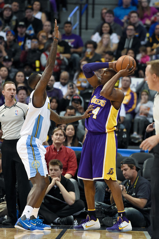 . DENVER, CO - MARCH 02: Los Angeles Lakers forward Kobe Bryant (24) looks to make a pass on Denver Nuggets guard JaKarr Sampson (9) March 2, 2016 at Pepsi Center. This is Kobe\'s last game in Denver as he retires at the end of the season. (Photo By John Leyba/The Denver Post)