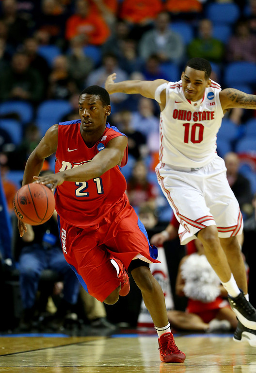. Dyshawn Pierre #21 of the Dayton Flyers brings the ball up the floor against the Ohio State Buckeyes during the second round of the 2014 NCAA Men\'s Basketball Tournament at the First Niagara Center on March 20, 2014 in Buffalo, New York.  (Photo by Elsa/Getty Images)