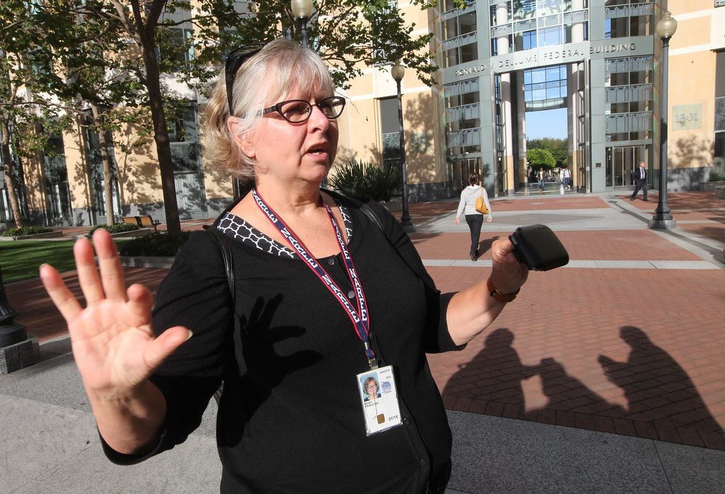 """. Francine Roby, executive director of the Federal Executive Board, calls the shutdown \""""demoralizing\"""" for the federal workers affected by the government shutdown on Tuesday, Oct. 1, 2013, outside the Ron Dellums Federal Building in Oakland, Calif.  The gridlock in Congress has partially shutdown the federal government allowing many federal workers half a day to prepare their offices for closure.  (Laura A. Oda/Bay Area News Group)"""
