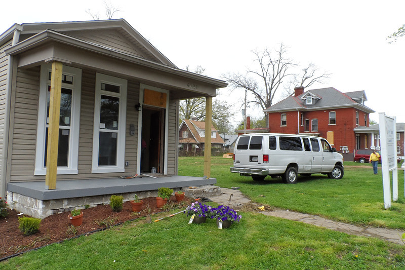 This once vacant house is being restored and will be dedicated for homeowner Connie Cash, a Youth Build graduate, on April 19, 2013. In the background is the donated property that will become The Fuller Center for Housing of Louisville's new headquarters.