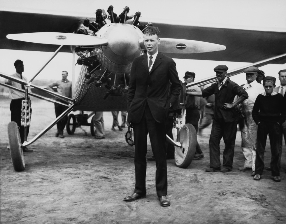 ". 1927: Charles Lindbergh. Aviator Charles A. Lindbergh stands in front of his plane ""The Spirit of St. Louis\"" in New York in before his historic solo flight to Paris, May 20, 1927. (AP Photo)"
