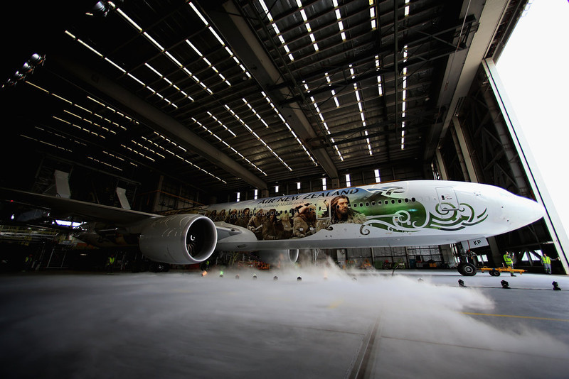 ". Air New Zealand unveils a 777-300 aircraft with imagery from The Hobbit ahead of the ""The Hobbit: An Unexpected Journey\"" world premiere at Auckland International Airport on November 24, 2012 in Auckland, New Zealand.The imagery depicts characters from the upcoming film and extends the full 73 metre length of the aircraft.  (Photo by Phil Walter/Getty Images)"