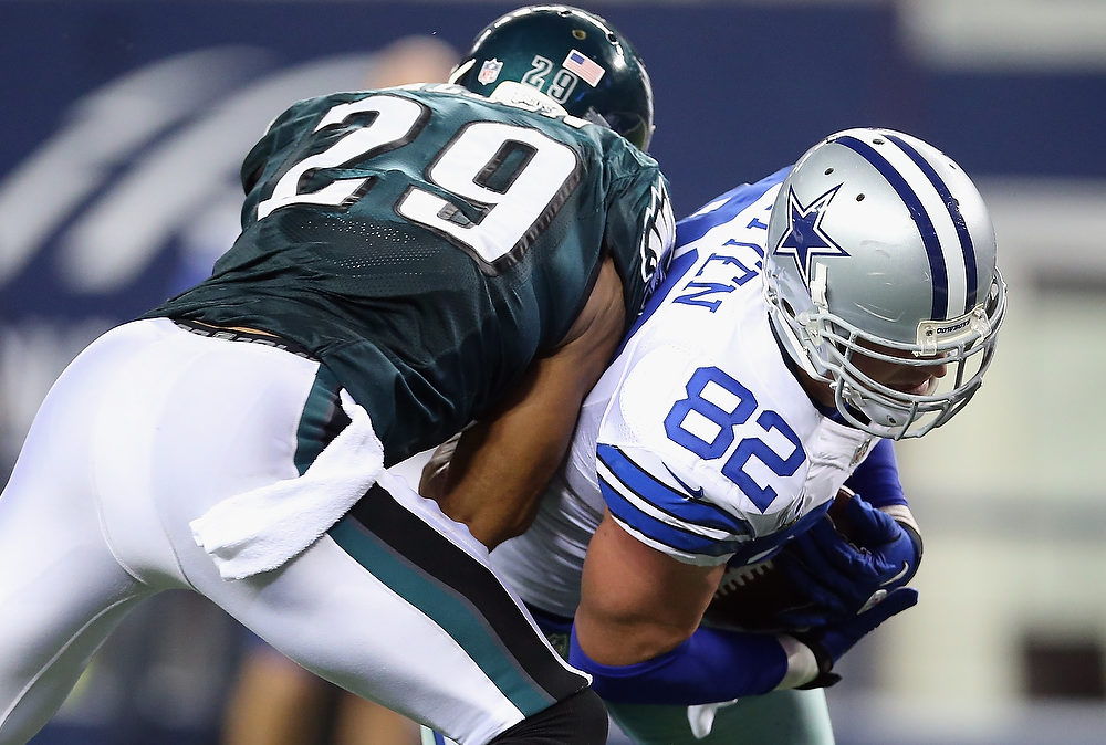 . Jason Witten #82 of the Dallas Cowboys runs the ball against  Nate Allen #29 of the Philadelphia Eagles at Cowboys Stadium on December 2, 2012 in Arlington, Texas.  (Photo by Ronald Martinez/Getty Images)