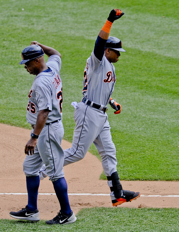 . Detroit Tigers Yoenis Cespedes (52) high-fives with Detroit Tigers third base coach Dave Clark (25) after hitting a home run during the sixth inning of baseball game against the Chicago White Sox in Chicago on Sunday, June 7,  2015. (AP Photo/Matt Marton)