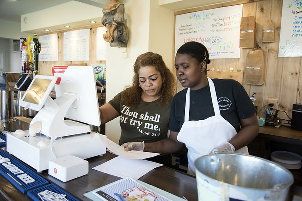 03/18/20 Wesley Bunnell | Staff Carmen Guadalupe, L, and Rose Luxier look over an online order received by their restaurant The Clam Box on Wednesday March 18, 2020. Restaurants were forced to stop inside dining and turn to take out and delivery only to help stop the speed of the Coronavirus.