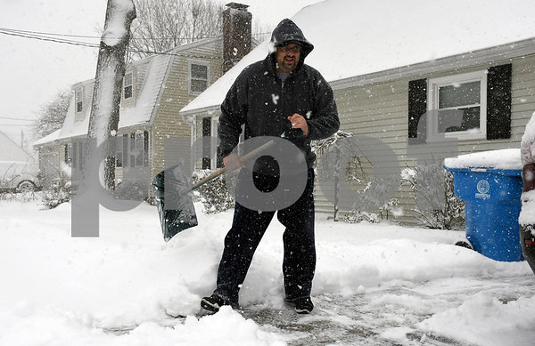 3/13/2018 Mike Orazzi | Staff Kelley McIntyre shovels his driveway on Concord Street during Tuesday's storm in Bristol.