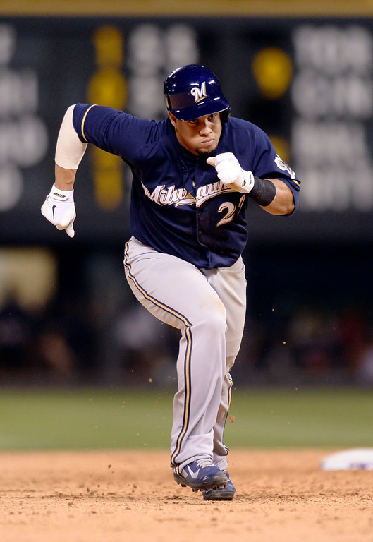 . DENVER, CO - JUNE 20: Milwaukee baserunner Carlos Gomez took off from second base on a single by Khris Davis in the sixth inning. Gomez scored to make the Brewers lead 10-6. The Colorado Rockies hosted the Milwaukee Brewers at Coors Field Friday night, June 20, 2014. Photo by Karl Gehring/The Denver Post