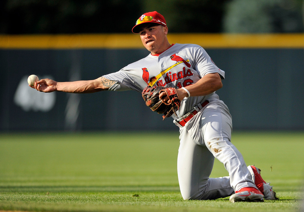 . St. Louis Cardinals second baseman Kolten Wong throws to first, but too late, as Colorado Rockies\' Charlie Culberson singles during the 11th inning of a baseball game Thursday, Sept. 19, 2013, in Denver. (AP Photo/Jack Dempsey)