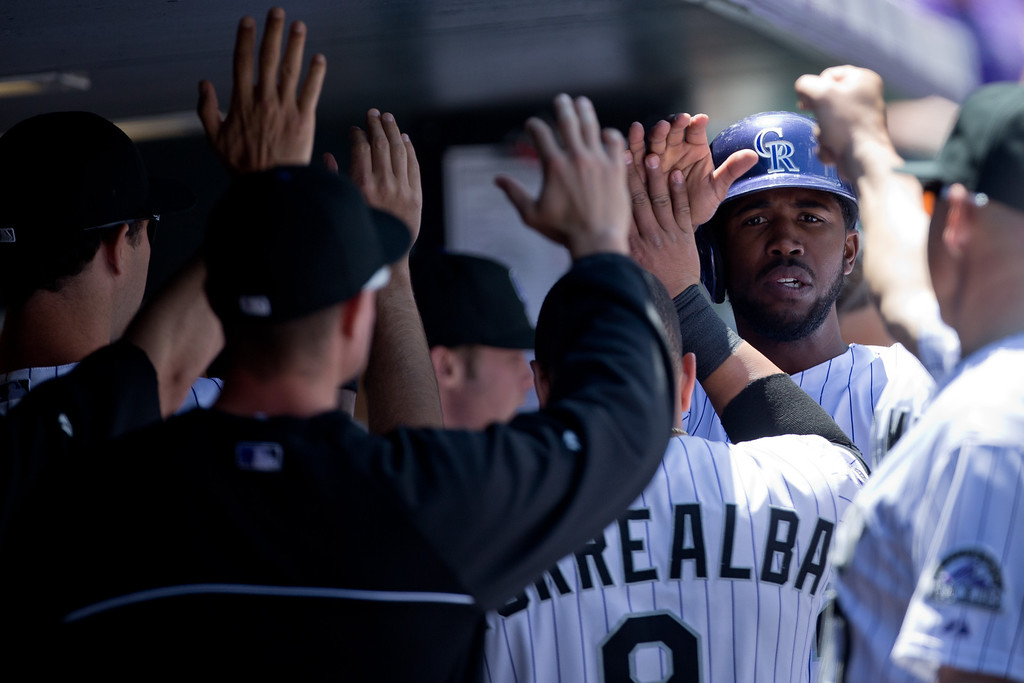 . Dexter Fowler #24 of the Colorado Rockies celebrates in the dugout after scoring during the first inning against the Arizona Diamondbacks at Coors Field on May 22, 2013 in Denver, Colorado. (Photo by Justin Edmonds/Getty Images)