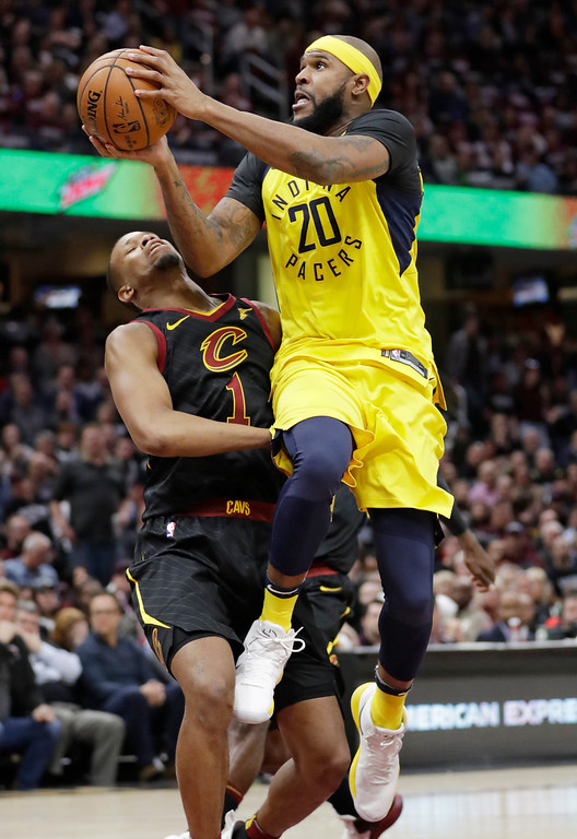 . Indiana Pacers\' Trevor Booker (20) drives to the basket against Cleveland Cavaliers\' Rodney Hood during the second half of Game 2 of an NBA basketball first-round playoff series, Wednesday, April 18, 2018, in Cleveland. Hood was called for a foul. The Cavaliers won 100-97. (AP Photo/Tony Dejak)