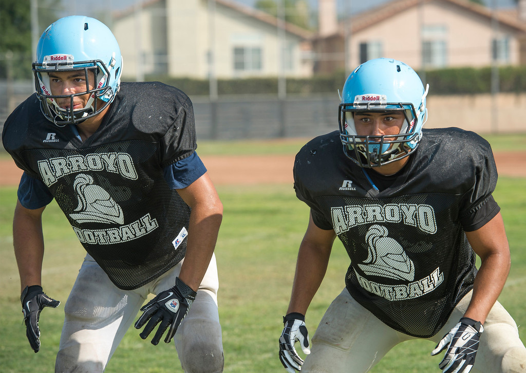 . Arroyo High linebackers Jesus Calvillo and Jose Valdivia during preseason practice at the El Monte campus August 14, 2013.   (SGVN/Staff photo by Leo Jarzomb)