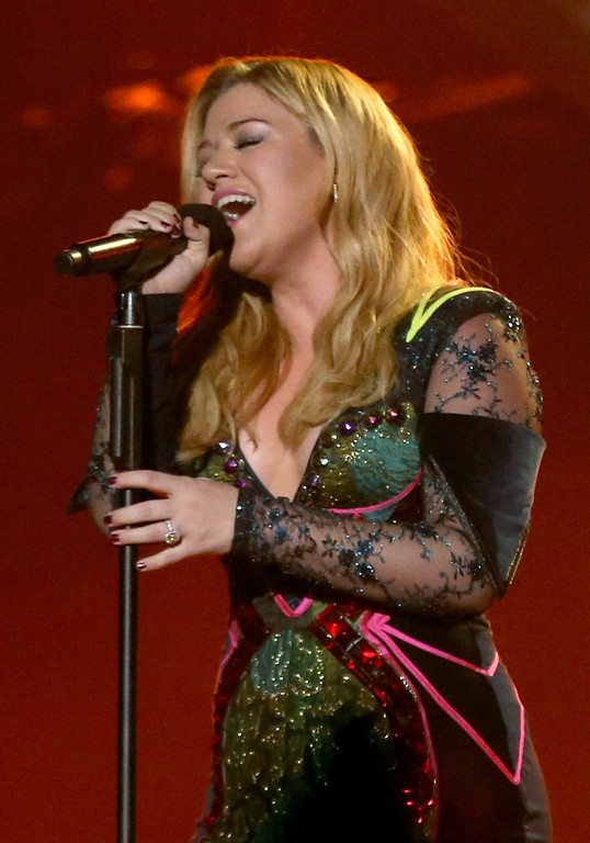 ". LOS ANGELES, CA - DECEMBER 16:  Singer Kelly Clarkson performs onstage during ""VH1 Divas\"" 2012 at The Shrine Auditorium on December 16, 2012 in Los Angeles, California.  (Photo by Christopher Polk/Getty Images)"