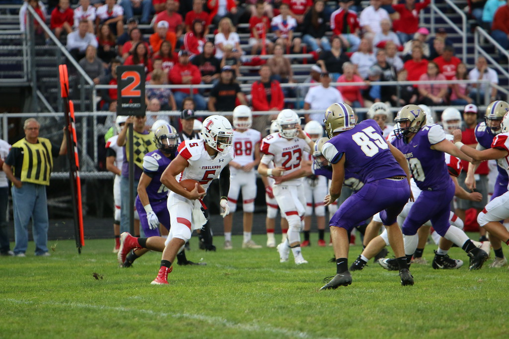 . Kyle Sooy - The Morning Journal<br> Firelands quarterback Blake Ruffner works thought the Vermilion defense on Sept. 7.
