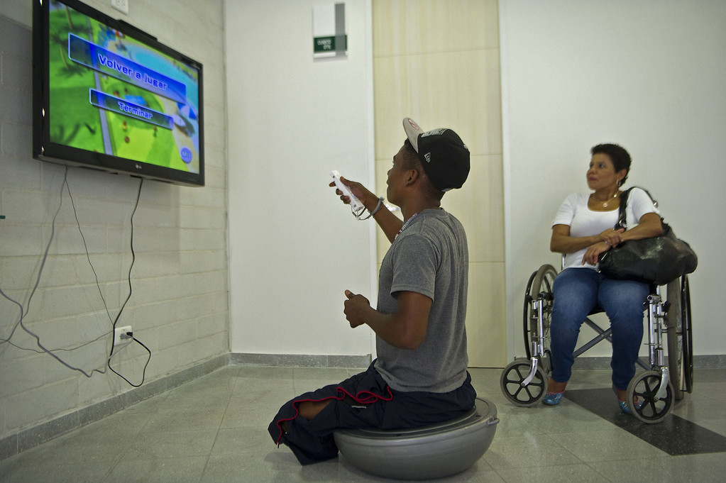 . Colombian soldier Aldemar Benitez (L), 23, plays on a console game during his rehabilitation therapy session.  RAUL ARBOLEDA/AFP/Getty Images