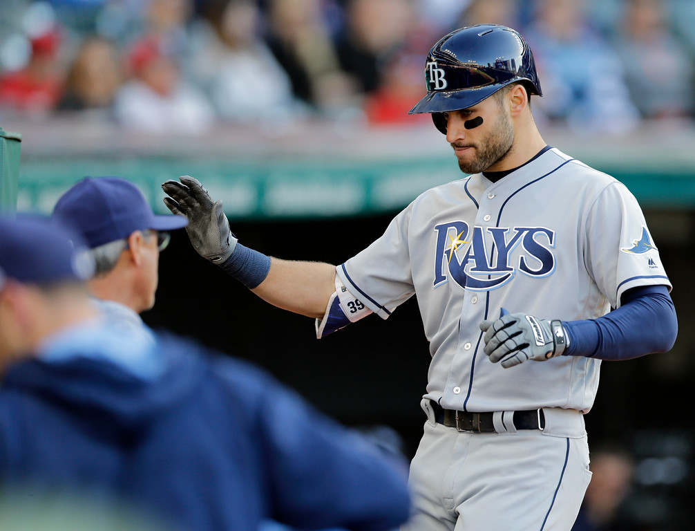 . Tampa Bay Rays\' Kevin Kiermaier is congratulated by teammates after hitting a solo home run off Cleveland Indians starting pitcher Carlos Carrasco in the second inning of a baseball game, Monday, May 15, 2017, in Cleveland. (AP Photo/Tony Dejak)