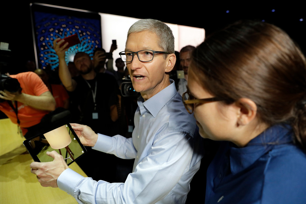 . Apple CEO Tim Cook shows an iPad Pro during an announcement of new products at the Apple Worldwide Developers Conference Monday, June 5, 2017, in San Jose , Calif. (AP Photo/Marcio Jose Sanchez)