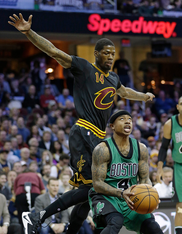 . Boston Celtics\' Isaiah Thomas (4) drives against Cleveland Cavaliers\' DeAndre Liggins (14) in the first half of an NBA basketball game, Thursday, Dec. 29, 2016, in Cleveland. (AP Photo/Tony Dejak)