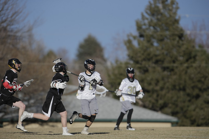 JPM0149-JPM0149-Jonathan first HS lacrosse game March 9th.jpg