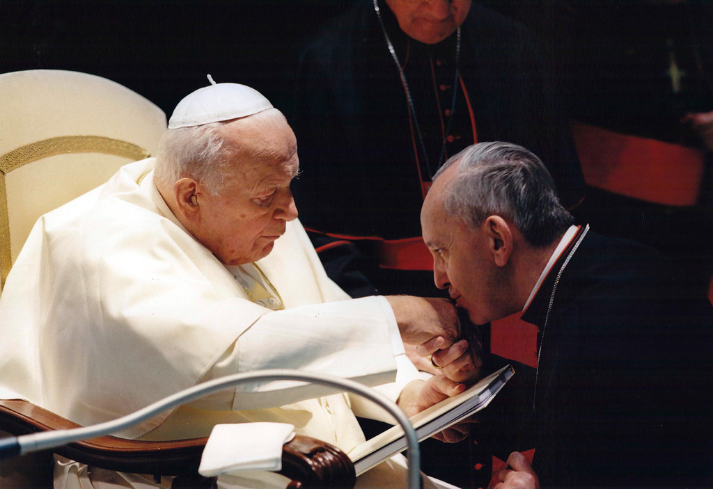 . In this undated picture released by journalist Sergio Rubin, Jorge Mario Bergoglio, Archbishop of Buenos Aires, right, kisses the hand of late Pope John Paul II during a ceremony at the Vatican. Bergoglio, who took the name of Pope Francis, was elected on Wednesday, March 13, 2013 the 266th pontiff of the Roman Catholic Church. (AP Photo/Courtesy of Sergio Rubin, ho)