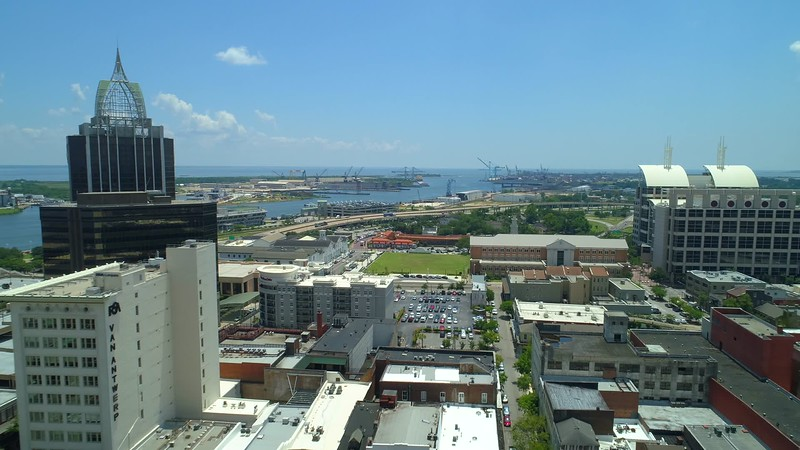 Aerial reveal Port Mobile Alabama behind Downtown cityscape