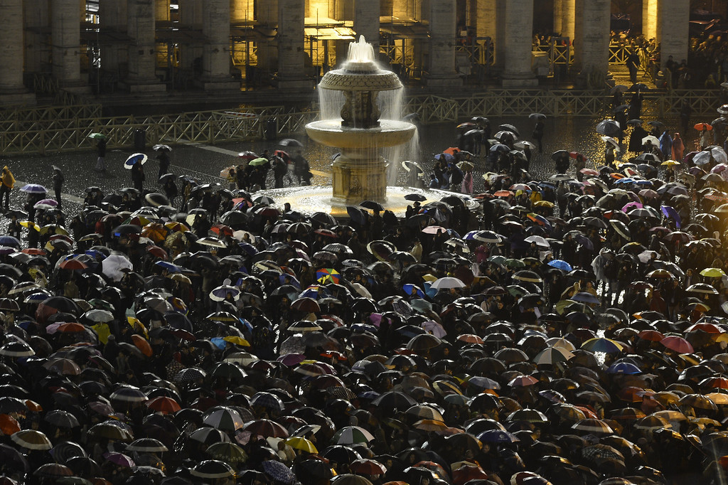 . Faithfuls wait under rain for the smoke announcing the result on the second day of the papal election conclave on March 13, 2013 at St Peter\'s square at the Vatican. In a rain-swept St Peter\'s Square, tens of thousands of people were hoping today to see the puff of smoke that would signal that cardinals meeting inside the chapel had reached a decision on who should be the next pope. Despite two puffs of black smoke in as many days, signaling that the 115 cardinals in the secret conclave had yet to choose a successor to Benedict XVI, many in the crowd were optimistic.        AFP PHOTO / FILIPPO MONTEFORTE/AFP/Getty Images