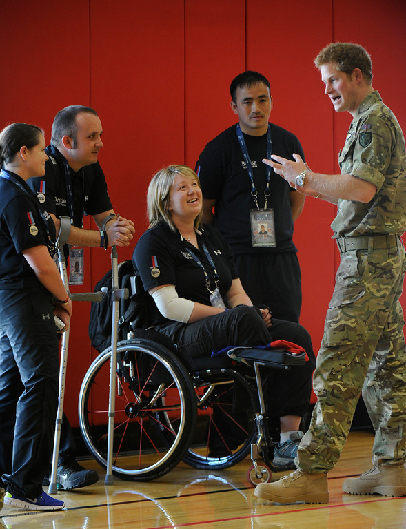 . COLORADO SPRINGS, CO - MAY 11: Britain\'s Prince Harry meets members of the British Armed Forces from left to right, Stacey Byrne, Karl Harvey, Erica Vey and Kushal Limbu, at the United States Olympic Training Center before the opening ceremonies of the 2013 Warrior Games Saturday morning, May 11th, 2013 at the OTC. (Photo By Andy Cross/The Denver Post)