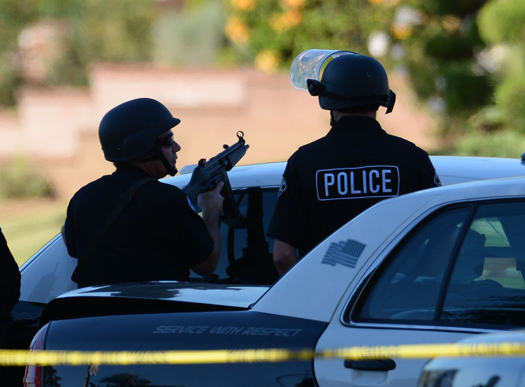 . A man allegedly shot an Inglewood police officer Wednesday, November 27, 2013, in Inglewood, CA, and the took hostages as he barricaded inside a house on S. 5th Avenue.  Officers watch the house from a block away with assault rifles at the ready. Photo by Steve McCrank/DailyBreeze