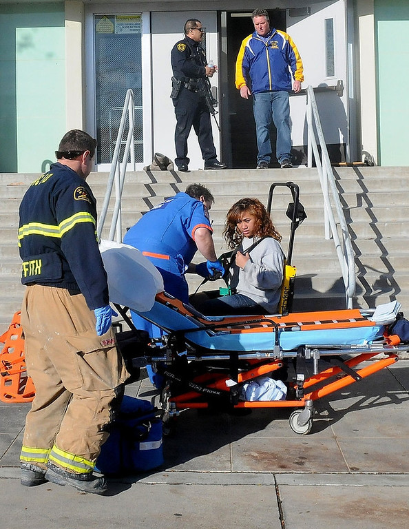 . This image provided by the Taft Midway Driller/Doug Keeler shows paramedics assisting a student wounded during a shooting Thursday Jan. 10, 2013 at San Joaquin Valley high school in Taft, Calif. Authorities said a student was shot and wounded and another student was taken into custody. (AP Photo/Taft  Midway Driller, Doug Keeler)
