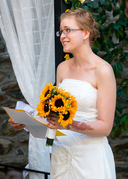 Bride at the altar reading vows 2.jpg