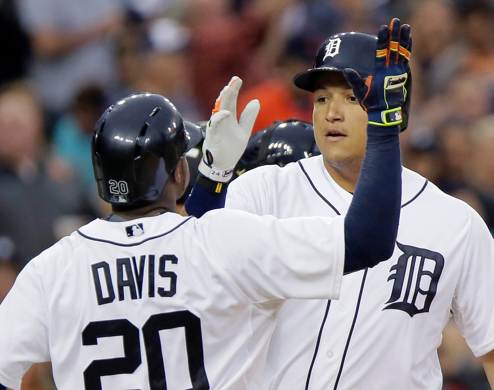 . Detroit Tigers\' Miguel Cabrera celebrates his three-run home run against the Cleveland Indians with Rajai Davis (20) during the sixth inning of a baseball game Friday, June 12, 2015, in Detroit. The Tigers defeated the Indians 4-0. (AP Photo/Duane Burleson)