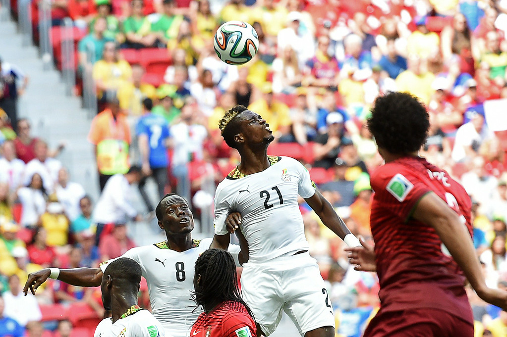 . Ghana\'s defender John Boye (top) heads the ball during the Group G football match between Portugal and Ghana at the Mane Garrincha National Stadium in Brasilia during the 2014 FIFA World Cup on June 26, 2014. CARL DE SOUZA/AFP/Getty Images
