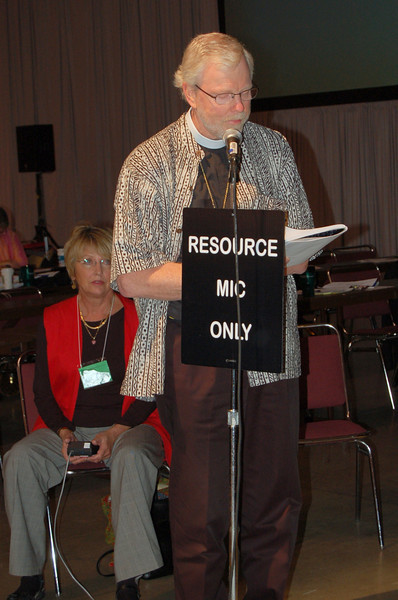"The Rev. Murray Finck, bishop, Pacifica Synod leads the assembly in prayer before the vote ""that the ELCA commit itself to finding ways to allow congregations that choose to do so to recognize, support, and hold publicly accountable life-long, monogamous, same-gender relationships."""