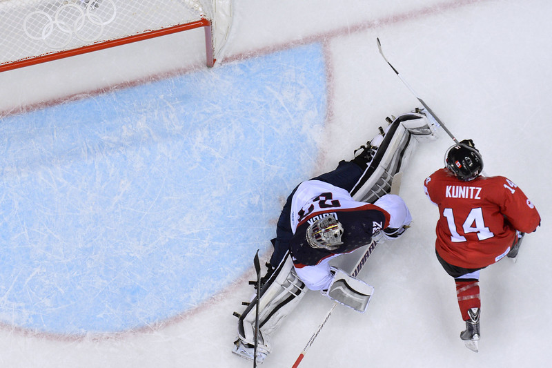 . Canada\'s Chris Kunitz (R) tries to score against US goalkeeper Jonathan Quick during the Men\'s Ice Hockey Semifinals USA vs Canada at the Bolshoy Ice Dome during the Sochi Winter Olympics on February 21, 2014.   ALEXANDER NEMENOV/AFP/Getty Images