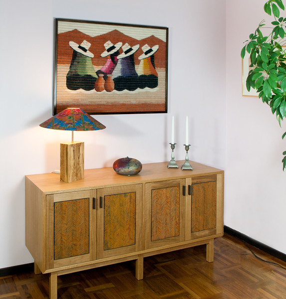 Sideboard and lamp in oak. Textile bought in local market in Pisaq, Peru