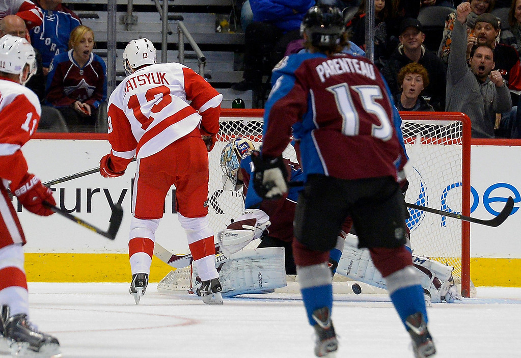 . Detroit Red Wings center Pavel Datsyuk (13) scores a goal on Colorado Avalanche goalie Semyon Varlamov (1) as the puck hit the back of the net during the first period October 17, 2013 at Pepsi Center.(Photo by John Leyba/The Denver Post)