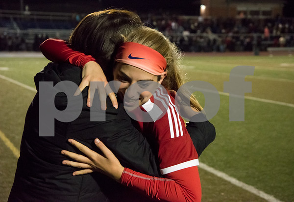 11/14/17 Wesley Bunnell | Staff Berlin girls soccer defeated Lewis Mills 2-1 (PK's 2-1) Tuesday night at Middletown High School to advance to the championship game. Captain Julia Sisti (3) is congratulated by a coach.