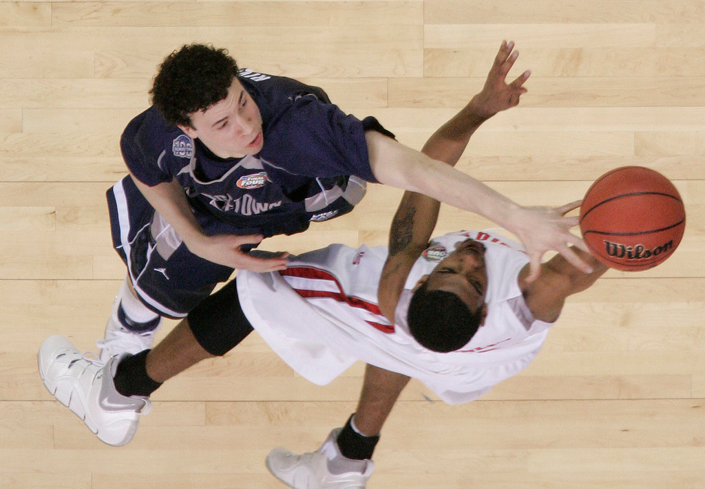 . Georgetown\'s Jeremiah Rivers (5) blocks the shot of Ohio State\'s Mike Conley Jr. during their NCAA Final Four game at the Georgia Dome in Atlanta Saturday, March 31, 2007. (AP Photo/John Bazemore)