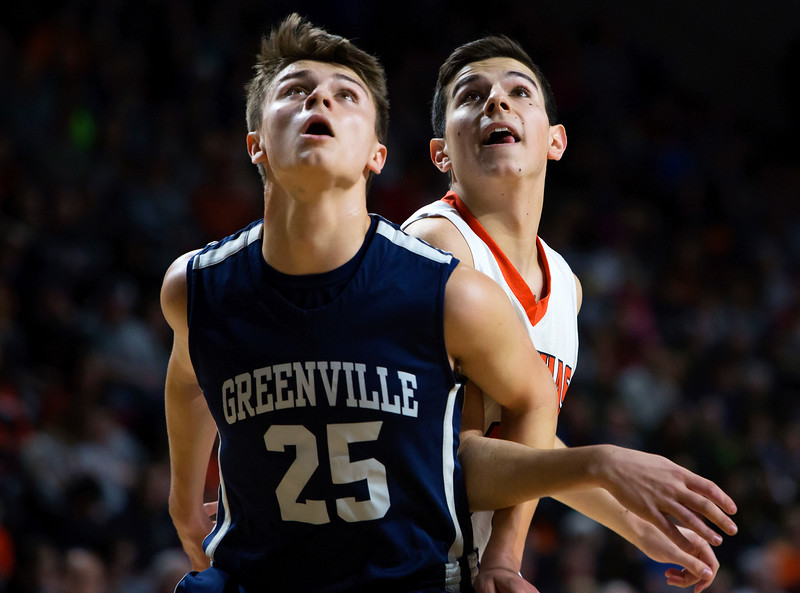 BANGOR, Maine -- 03/04/2017 -- Greenville's Connor DiAngelo (left) and Machias' John Massaad wait to see if a free throw drops during their Class D boys basketball state championship at the Cross Insurance Center in Bangor Saturday. Ashley L. Conti   BDN