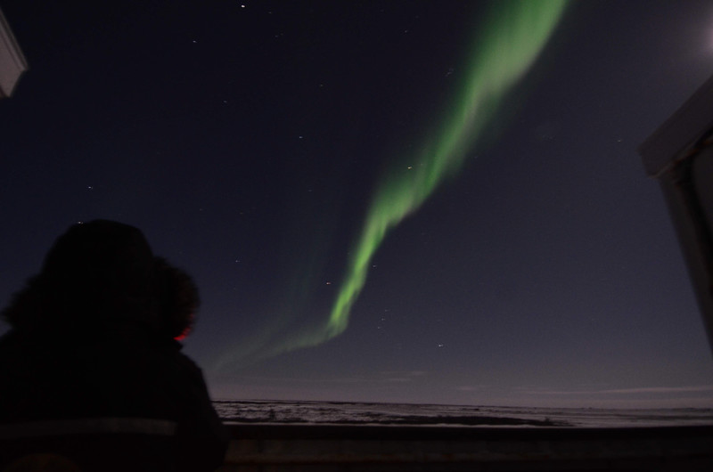 Aunika & Aurora Borealis from tundra lodge parked near Hudson Bay