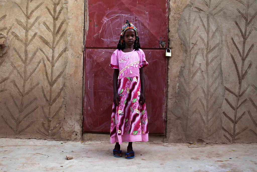 . Aminata Toure, 10, wears a traditional Songhai headdress made by artisan Hally Bara in Gao, Mali, March 6, 2013. Radical Islamist group MUJAO placed limitations on the wearing of traditional women\'s headdresses during their nine-month reign in Gao, which ended in January with the arrival of French and Malian troops. The headdresses, made of beads, gemstones, fabric and fake hair and traditionally worn by elites for special occasions, were criticised by MUJAO who said they were not Islamic enough. Issues surrounding the treatment of women are receiving special attention on March 8, which marks International Womenís Day. Picture taken March 6, 2013. REUTERS/Joe Penney