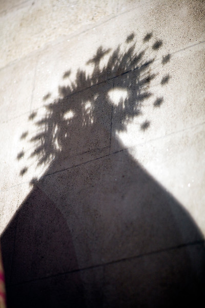 The shadow of a Virgin Mary image on a wall, Santiago church, Caceres, Spain