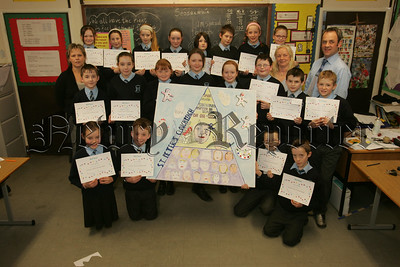 St Peter's Cloughreagh take part in the Helping Hands project in aid of Womens aid, Pictured with the Primary 7 pupils are, Martina Shevlin and Ann Baxter from Womens Aid and Teacher Mr Christopher McCann. 07W8N25