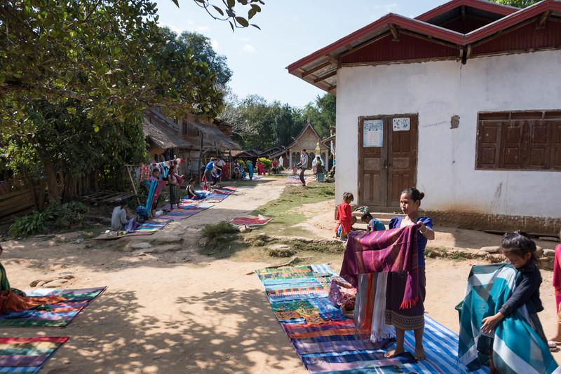 Women selling stoles in village, Sainyabuli Province, Laos