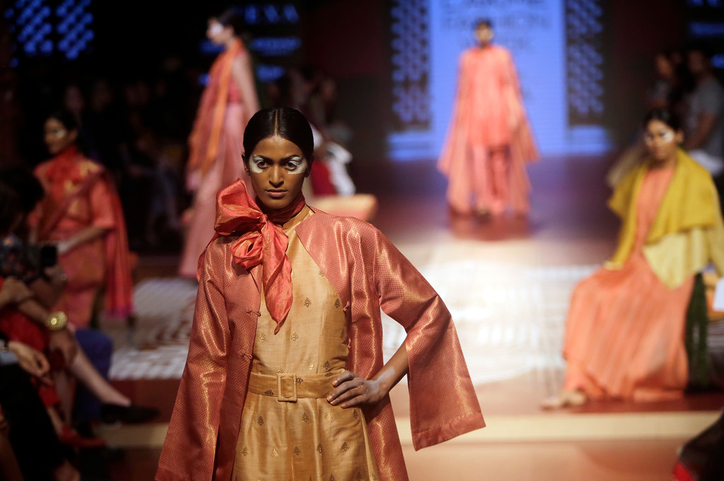 . Models walk the ramp to showcase the creation of designer Sunita Shanker during Lakme fashion week winter 2018 in Mumbai, India, Thursday, Aug. 23, 2018. (AP Photo/Rajanish Kakade)