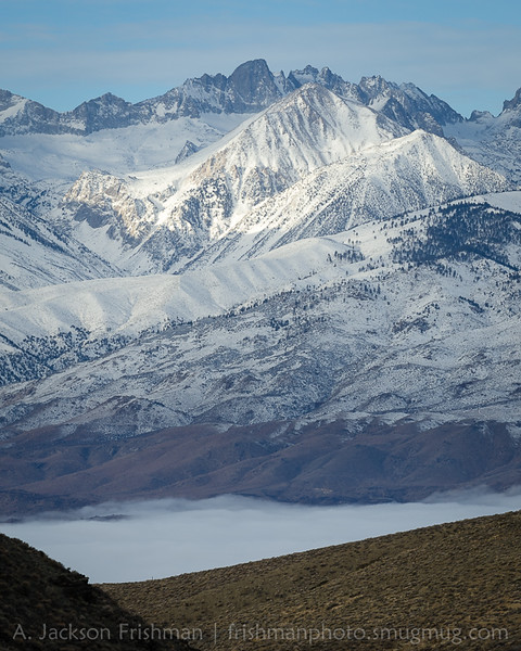 North Palisade and Mount Sill tower above a foggy Owens Valley, January 2016.