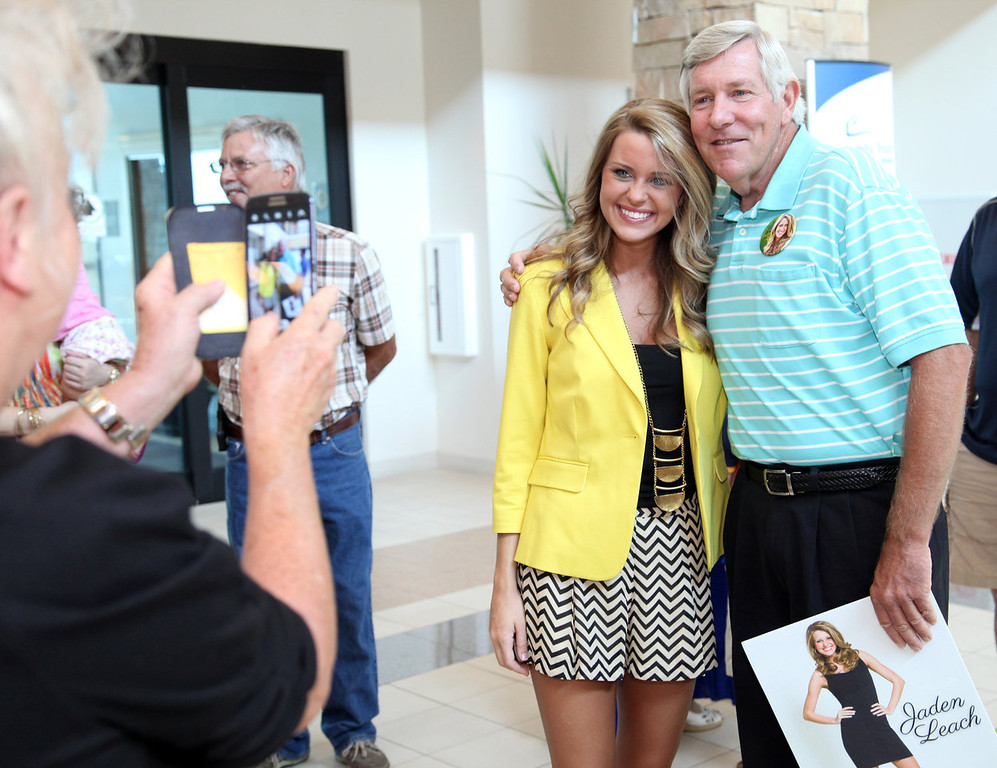 . Family and friends gather to send off Miss Louisiana 2013, Jaden Leach, center left, at the Monroe Regional Airport in Monroe, La., on Monday, Sept. 2, 2013. Leach is headed to compete in the Miss America Pageant in Atlantic City, N.J.  (AP Photo/The News-Star, Dacia Idom)