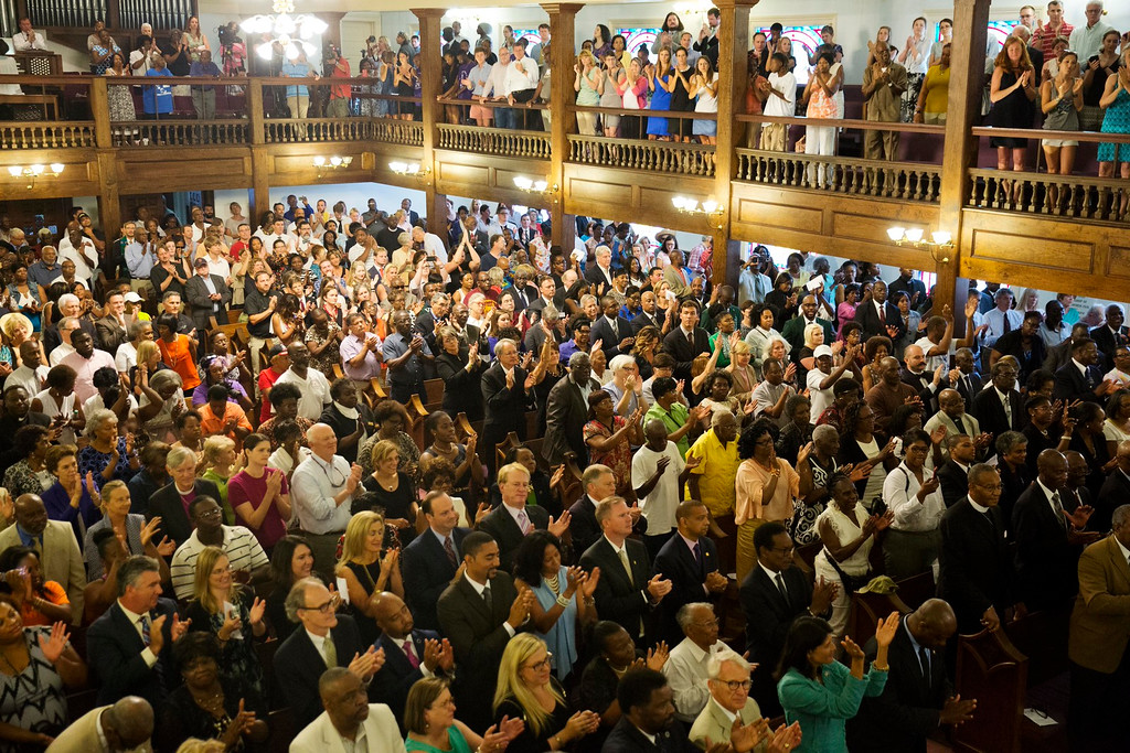 . Parishioners applaud during a memorial service at Morris Brown AME Church for the people killed Wednesday during a prayer meeting inside a historic black church in Charleston, S.C., Thursday, June 18, 2015. Police arrested 21-year-old suspect Dylann Storm Roof Thursday in Shelby, N.C. without resistance. (AP Photo/David Goldman)