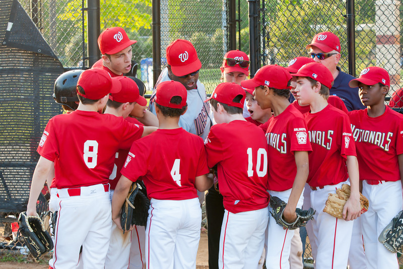 Coach Coop getting the team fired up as they go into the bottom of the 6th inning trailing by one. The Nationals played an excellent defensive game, but came up just a little short against the Pirates who scored the go-ahead run in the top of the 6th inning, winning 2-1. They are now 4-3 for the season. 2012 Arlington Little League Baseball, Majors Division. Nationals vs Pirates (01 May 2012) (Image taken by Patrick R. Kane on 01 May 2012 with Canon EOS-1D Mark III at ISO 800, f8.0, 1/80 sec and 90mm)