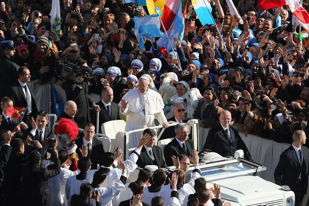 . Pope Francis attends his Inauguration Mass in St Peter\'s Square on March 19, 2013 in Vatican City, Vatican. The mass is being held in front of an expected crowd of up to one million pilgrims and faithful who have filled the square and the surrounding streets to see the former Cardinal of Buenos Aires officially take up his role as pontiff. Pope Francis� inauguration takes place in front of Cardinals and spiritual leaders as well as heads of state from around the world.  (Photo by Dan Kitwood/Getty Images)
