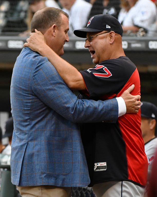 . Chicago White Sox great Jim Thome, left, a 2018 inductee at the Baseball Hall of Fame, talks with Cleveland Indians manager Terry Francona before a baseball game  Saturday, Aug. 11, 2018, in Chicago. (AP Photo/Matt Marton)